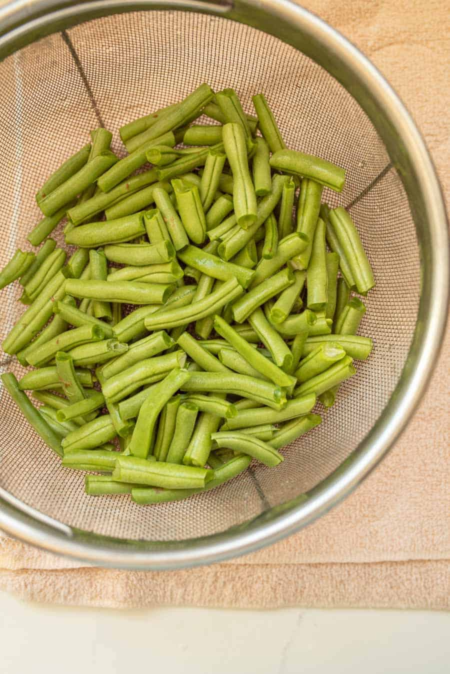 snapped green beans in strainer