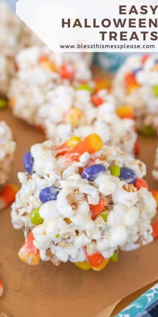 no bake halloween popcornballs treats on a sheetpan with text on image