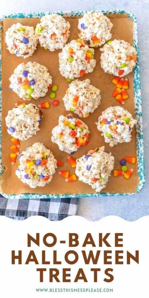 no bake halloween popcornballs and candy corn on a baking sheet