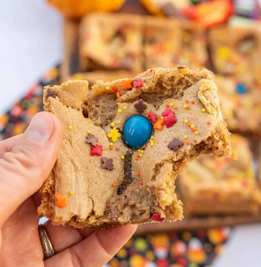 halloween cookie bar held in hand with one bite taken