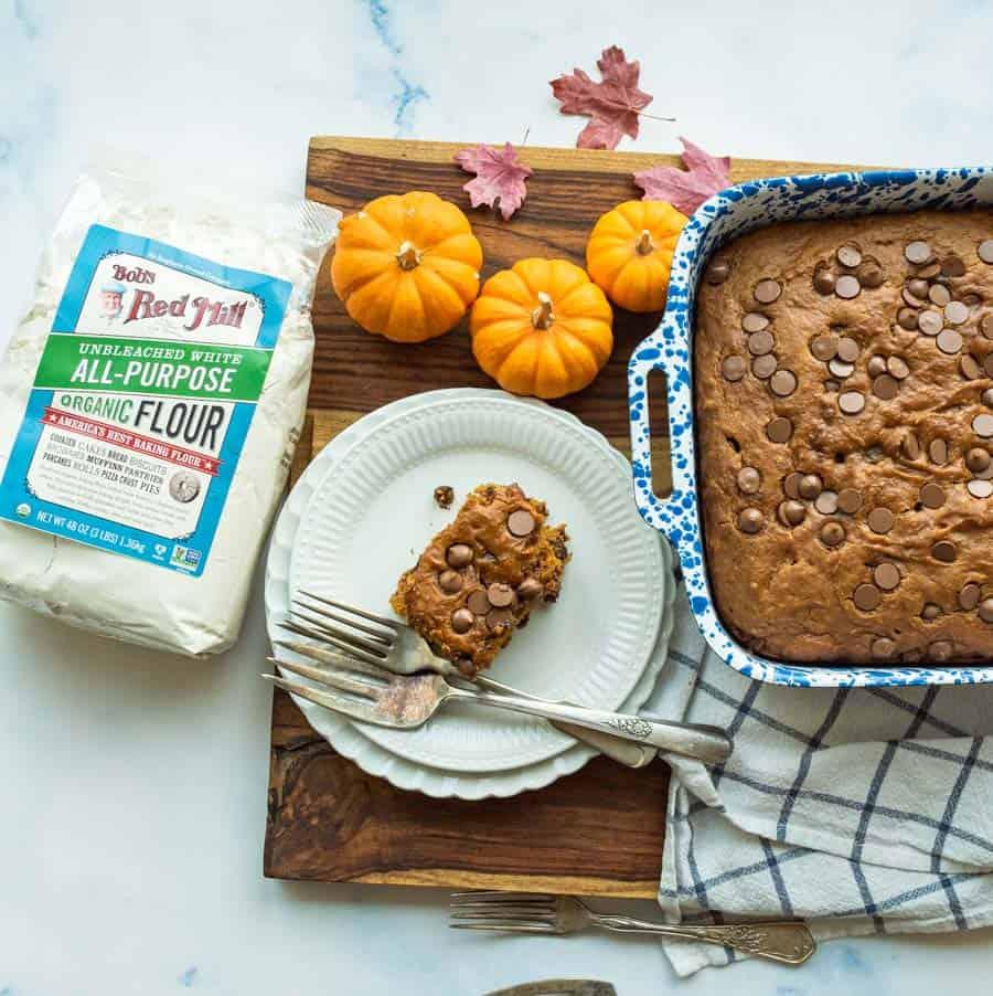 pumpkin cake cut into pieces in blue pan