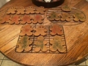 user submitted image of gingerbread people with sprinkles on top, baked