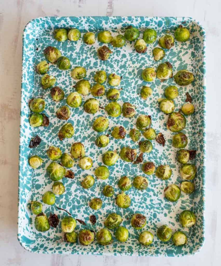 roasted brussel sprouts on a baking sheet