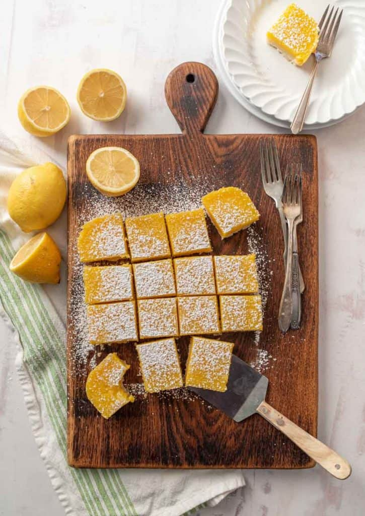 top view of lemon bars on wood cutting board