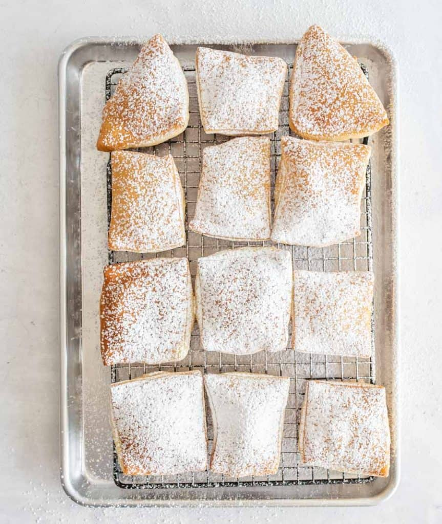 top view of beignets dusted with powdered sugar