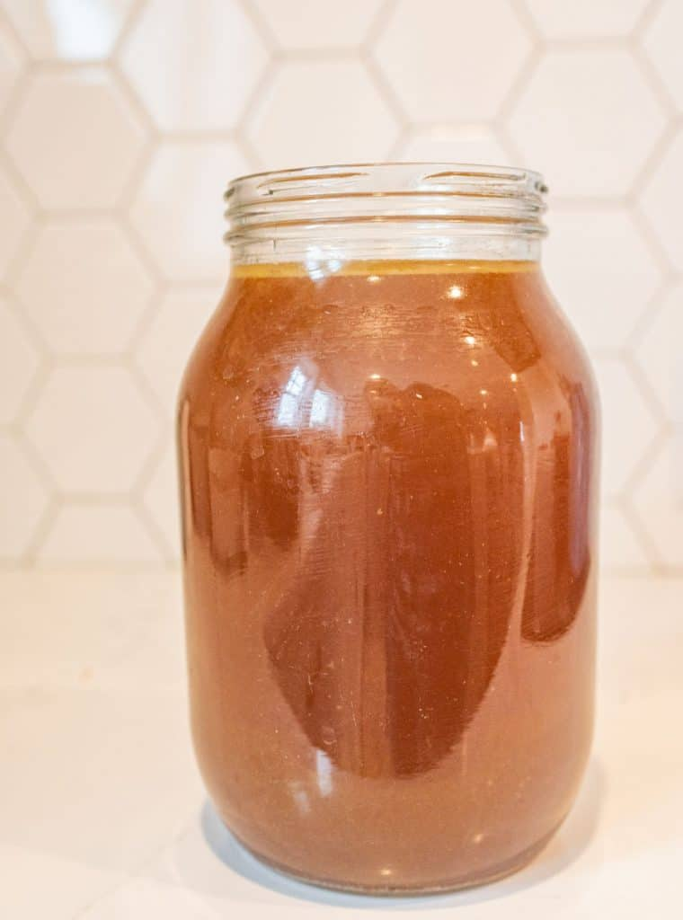 Picture of a glass jar filled with chicken broth