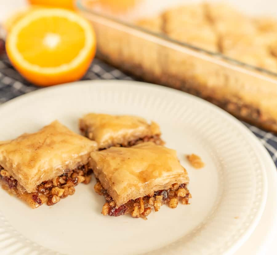 close up of a plate with slices of baklava on it