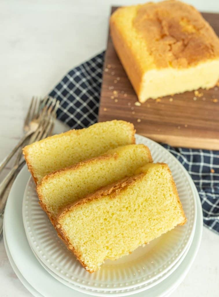 slices of pound cake on a plate with pound cake in the background