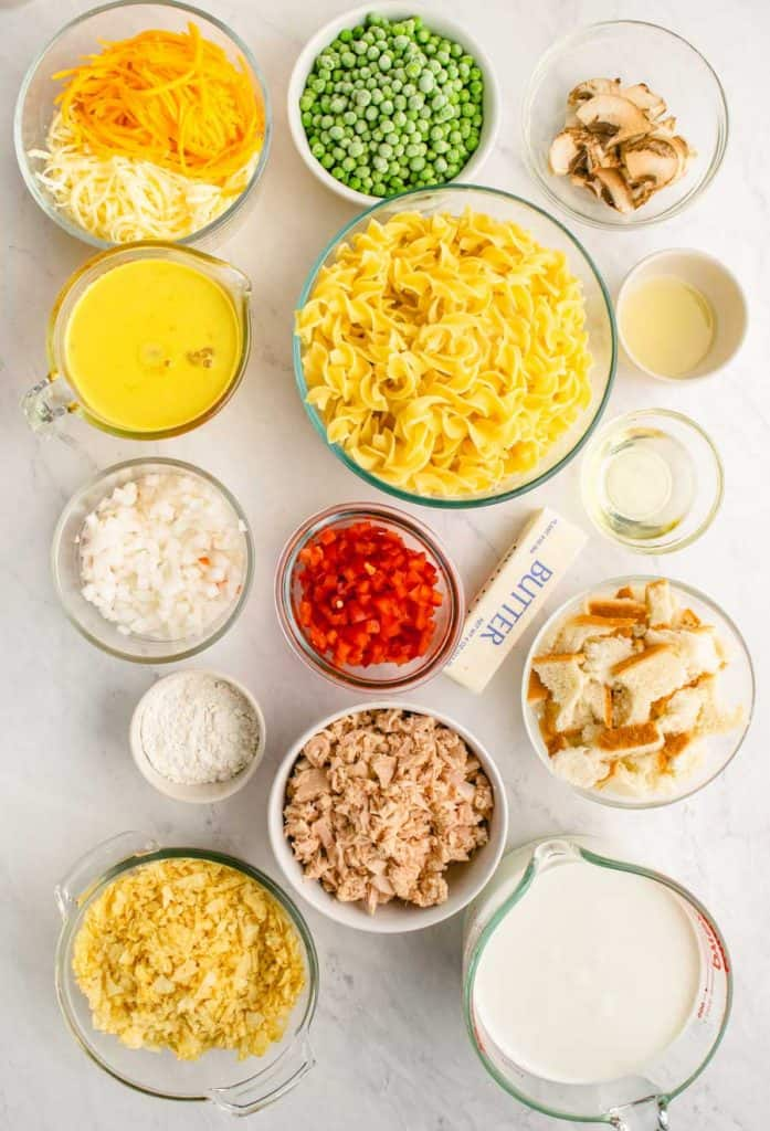 all of the ingredients for tuna noodle laid out in different bowls