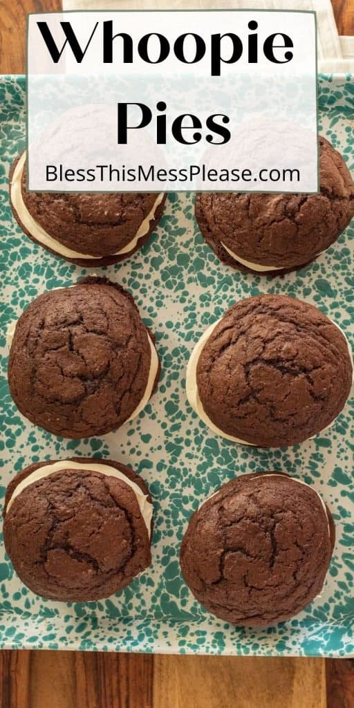 """top view of a pan of whoopie pie cookie sandwiches with the words """"whoopie pies"""" written at the top"""