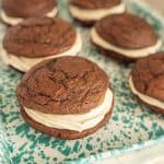 close up side view of whoopie pies on a tray